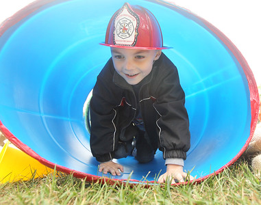 Candace H. Johnson-For Shaw Media Connor Kaminski, 5, of Grayslake goes through a tube in an obstacle course during the Busy Brains Children's Museum Fall Family Festival at Lehmann Park in Lake Villa. (9/29/18)