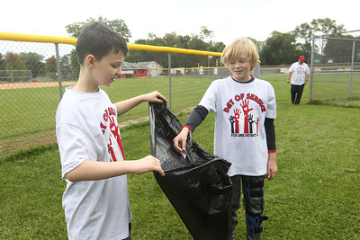 Candace H. Johnson-For Shaw Media Stanton Middle School's Logan Rossi, of Fox Lake and Gavin Hutchinson, of Spring Grove, both 11, pick up garbage at Veterans Park during the Fox Lake Grade School District 114's 4th Annual Day of Service. (9/28/18)