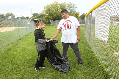 Candace H. Johnson-For Shaw Media Stanton Middle School's Isaehas Rico, of Fox Lake and Jarell McBride, of Spring Grove, both 12, pick up trash at Veterans Park during the Fox Lake Grade School District 114's 4th Annual Day of Service. (9/28/18)