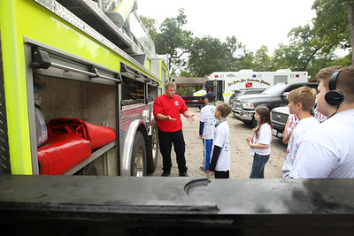 Candace H. Johnson-For Shaw Media Stanton Middle School students listen to Rob Rand, firefighter paramedic with the Fox Lake Fire Protection District, talk about how firefighters use a ladder truck after the students mopped floors and cleaned windows at Fire Station #2 during the Fox Lake Grade School District 114's 4th Annual Day of Service. (9/28/18)