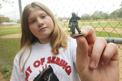 Candace H. Johnson-For Shaw Media Stanton Middle School's Ariana Serlick, 12, of Fox Lake holds a small plastic toy soldier she found while picking up trash at Veterans Park during the Fox Lake Grade School District 114's 4th Annual Day of Service. (9/28/18)