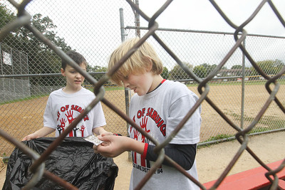 Candace H. Johnson-For Shaw Media Stanton Middle School's Logan Rossi, of Fox Lake and Gavin Hutchinson, of Spring Grove, both 11, look at a paper Gavin picked up while picking up trash at Veterans Park in Fox Lake during the Fox Lake Grade School District 114's 4th Annual Day of Service. (9/28/18)