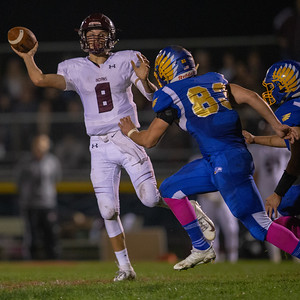 Marengo Quarterback Travis Knaak throws on the run Friday, October 5, 2018 in Johnsburg. Marengo takes the conference victory by the score of 16-14. KKoontz – For Shaw Media