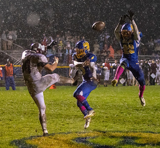Johnsburg's Max Kegel (center) and Casey Meland (right) block a punt by Marengo's Landon Oine (Left) which was run back for a touchdown by Ryan Linkletter with 4:41 left in the third quarter giving the Skyhawks a 14-13 lead Friday, October 5, 2018 in Johnsburg. Marengo came back to win the conference game 16-13.  KKoontz – For Shaw Media