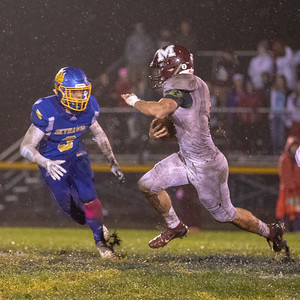 Marengo's Finn Schirmer finds some traction on a soggy field Friday, October 5, 2018 in Johnsburg. Marengo hands Johnsburg their first conference loss in two years winning 16-13. KKoontz – For Shaw Media