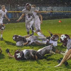 Marengo players celebrate the 16-14 win over Johnsburg with a victory slide in the mud Friday, October 5, 2018 in Johnsburg. Marengo moves to 4-0 in the conference. KKoontz – For Shaw Media