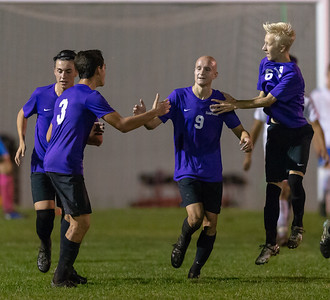 Hampshire soccer teammates celebrate Nathan Ludwig's (9) first period goal against Dundee-Crown Tuesday, October 9, 2018 in Hampshire. Dundee-Crown would take the win in overtime 2-1. KKoontz – For Shaw Media