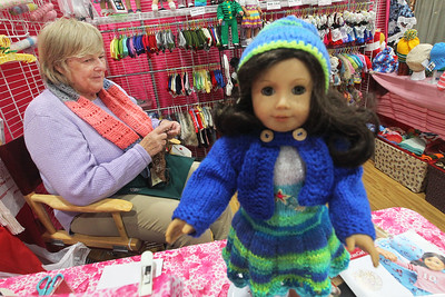 Candace H. Johnson-For Shaw Media Isabelle Herdeg, of Glen Ellyn, with Isabelle's Doll Closet, sits in her booth making hand-knitted doll clothes during the Art & Craft Show at the Lake County Fairgrounds in Grayslake. The event was hosted by Step By Step Promotions. The next craft show will be held at the Lake County Fairgrounds on Thanksgiving weekend, Friday through Sunday, November 23rd-25th.(10/7/18)