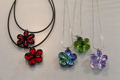 Candace H. Johnson-For Shaw Media Flower necklaces made with dichroic glass by artist Stephanie Tantillo, of Woodstock with Satori Fire Glass, were for sale during the Art & Craft Show at the Lake County Fairgrounds in Grayslake. The event was hosted by Step By Step Promotions. The next craft show will be held at the Lake County Fairgrounds on Thanksgiving weekend, Friday through Sunday, November 23rd-25th.(10/7/18)