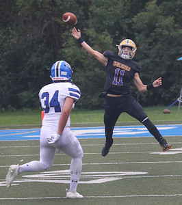 Candace H. Johnson-For Shaw Media Warren's quarterback Phil Hird (#11) throws a pass against Lake Zurich's Jason Sayre in the third quarter at Warren Township High School in Gurnee. Warren won 34-6. (10/6/18)