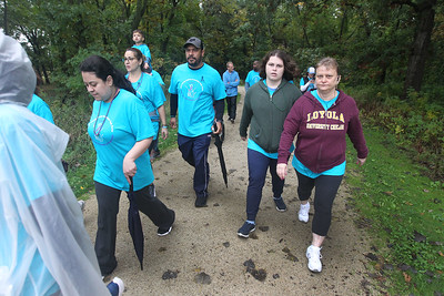 Candace H. Johnson-For Shaw Media A group of people walk together during the Lake County Suicide Prevention Task Force 6th Annual walk for Suicide Prevention and Awareness at Hastings Lake Forest Preserve in Lake Villa. (10/6/18)