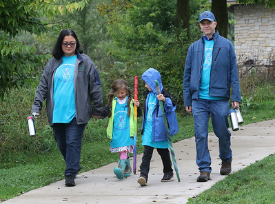 Candace H. Johnson-For Shaw Media Stephanie and Brandon Gray, of Wauconda walk with their children, Mayari, 5, and Lochlan, 6, during the Lake County Suicide Prevention Task Force 6th Annual walk for Suicide Prevention and Awareness at Hastings Lake Forest Preserve in Lake Villa. (10/6/18)