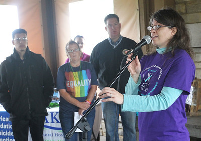 Candace H. Johnson-For Shaw Media Katia Marshall, of Lake Forest, chairwoman, speaks to the audience before the Lake County Suicide Prevention Task Force 6th Annual walk for Suicide Prevention and Awareness at Hastings Lake Forest Preserve in Lake Villa. (10/6/18)