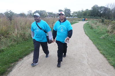 Candace H. Johnson-For Shaw Media William and Barbara Thornton, of Zion walk in honor of their friend and colleague, Dan Hoth, during the Lake County Suicide Prevention Task Force 6th Annual walk for Suicide Prevention and Awareness at Hastings Lake Forest Preserve in Lake Villa. (10/6/18)