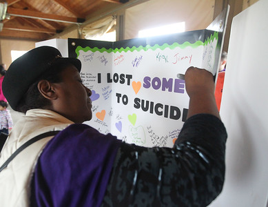 "Candace H. Johnson-For Shaw Media Miriam Smith, of Waukegan signs the ""I Lost Someone to Suicide"" sign in honor of her niece, Bertita Marquez during the Lake County Suicide Prevention Task Force 6th Annual walk for Suicide Prevention and Awareness at Hastings Lake Forest Preserve in Lake Villa. (10/6/18)"