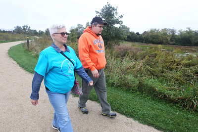 Candace H. Johnson-For Shaw Media Carol Frank, of Grayslake and her son, Owen, walk together during the Lake County Suicide Prevention Task Force 6th Annual walk for Suicide Prevention and Awareness at Hastings Lake Forest Preserve in Lake Villa. Carol was representing the Lake County chapter of the National Alliance on Mental Illness (NAMI).(10/6/18)