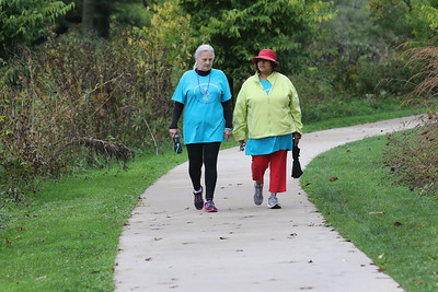 Candace H. Johnson-For Shaw Media Louise Moore, of Lake Villa and Yvette Bryant, of Waukegan walk together during the Lake County Suicide Prevention Task Force 6th Annual walk for Suicide Prevention and Awareness at Hastings Lake Forest Preserve in Lake Villa. Moore was walking in honor of her nephew, Steven Vermillion. (10/6/18)