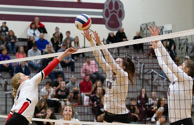 Huntley's Loren Alberts (L-R) drives the ball into the Prairie Ridge's Samantha Lockwood and Samantha Johnson Thursday, October 11, 2018 in Crystal Lake. Huntley went on to win the match in two straight sets, 25-22 and 25-17. KKoontz – For Shaw Media