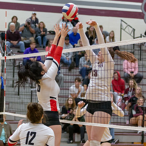 Huntley's Marissa Deem and Prairie Ridge's Samantha Lockwood battle it out over the net Thursday, October 11, 2018 in Crystal Lake. Huntley went on to win the match in two straight sets, 25-22 and 25-17. KKoontz – For Shaw Media