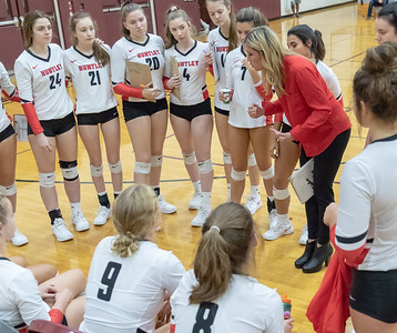 Huntley Head Volleyball Coach Karen Naymola talks with her team during a timeout against Prairie Ridge Thursday, October 11, 2018 in Crystal Lake. Huntley went on to win the match in two straight sets, 25-22 and 25-17. KKoontz – For Shaw Media