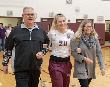 Prairie Ridge Head Volleyball Coach Stefanie Otto along with husband Dave Otto escort their daughter Jayden Otto into the gym for senior night Thursday, October 11, 2018 in Crystal Lake. Jayden is a four-year starting setter for the Wolves. KKoontz- For Shaw Media