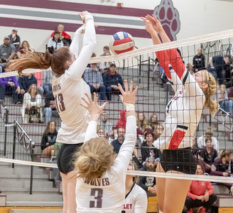 Prairie Ridge's Samantha Lockwood (Left) and Huntley's Loren Alberts battle it out at the net Thursday, October 11, 2018 in Crystal Lake. Huntley went on to win the match in two straight sets, 25-22 and 25-17. KKoontz – For Shaw Media