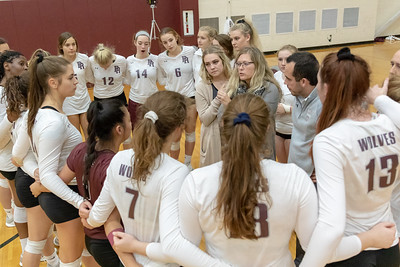 Prairie Ridge Head Volleyball Coach Stefanie Otto talks with her team during a timeout against Huntley Thursday, October 11, 2018 in Crystal Lake. Huntley went on to win the match in two straight sets, 25-22 and 25-17. KKoontz – For Shaw Media