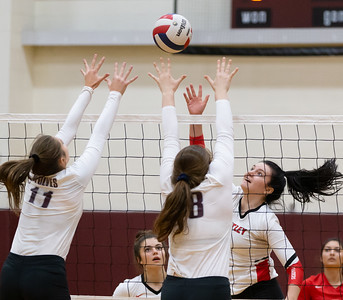 Huntley's Marissa Deem (Right) puts the ball over Prairie Ridge defenders Olivia Annen (11) and Madeline McGuire (18) Thursday, October 11, 2018 in Crystal Lake. Huntley went on to win the match in two straight sets, 25-22 and 25-17. KKoontz – For Shaw Media
