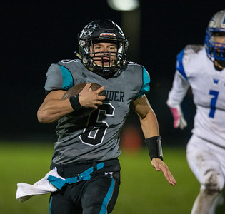 Woodstock North quarterback Ryan Zinnen runs outside against Woodstock Friday, October 12, 2018 in Woodstock. Woodstock North wins a close one 40-37. KKoontz – For Shaw Media
