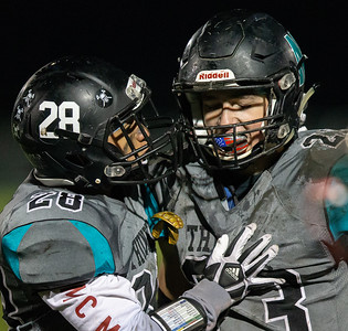 Woodstock North's Carlos Lopez (Left) congratulates teammate Colin Zinn after his interception in the fourth quarter against Woodstock Friday, October 12, 2018 in Woodstock. Woodstock North won the shoot-out 40-37. KKoontz – For Shaw Media