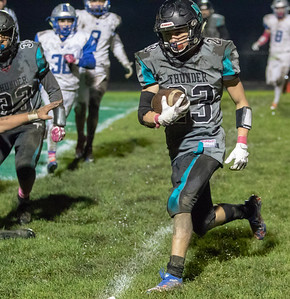 Woodstock North's Colin Zinn runs into the end zone for the two point conversion against Woodstock in the fourth quarter Friday, October 12, 2018 in Woodstock. Woodstock North wins a close one 40-37. KKoontz – For Shaw Media