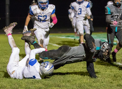 Woodstock North's Elijah Pena stretches for the end zone against Woodstock Friday, October 12, 2018 in Woodstock. Woodstock North wins a close one 40-37. KKoontz – For Shaw Media