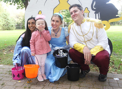 Candace H. Johnson-For Shaw Media Saige Rettig, 3, of Presidio, Texas reacts as she get her photo taken with the Fairy Godmother, Cinderella and the Prince on the Trick or Treat Path at Viking Park in Gurnee. The characters were played by Diya Iyer, 16, Julia Paukert, 17, both of Gurnee and West Knobbe, 27, of Wadsworth.Saige was in town visiting her grandmother, Lorena Davila, of Gurnee.The event was sponsored by the Gurnee Park District. (10/13/18)