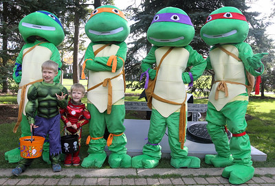 Candace H. Johnson-For Shaw Media Henry Degner, 5, of Grayslake and his brother, Wyatt, 2, get their photo taken with the Teenage Mutant Ninja Turtles on the Trick or Treat Path at Viking Park in Gurnee. The event was sponsored by the Gurnee Park District. (10/13/18)