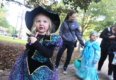 Candace H. Johnson-For Shaw Media Meah Kral, 3, of Gurnee, dressed as a witch, walks through the Trick or Treat Path with Amy Hoehne, of Lake Bluff and her daughter Sophia Ocampo, 4, behind her at Viking Park in Gurnee. The event was sponsored by the Gurnee Park District. (10/13/18)
