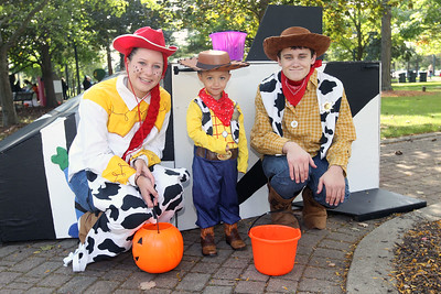 Candace H. Johnson-For Shaw Media Romeo Avalos, 3, of Waukegan, dressed as Woody, (center) gets his photo taken with Jessie and Woody from Toy Story on the Trick or Treat Path at Viking Park in Gurnee. Nora Jersild and Eric Oberstar, both 17, of Gurnee played the Disney characters. The event was sponsored by the Gurnee Park District. (10/13/18)