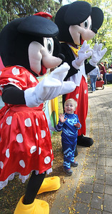 Candace H. Johnson-For Shaw Media Giuseppe Azzone, 2, of Gurnee waves to Minnie and Mickey Mouse on the Trick or Treat Path at Viking Park in Gurnee. The event was sponsored by the Gurnee Park District. (10/13/18)