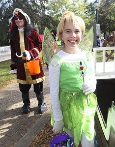 Candace H. Johnson-For Shaw Media Mike Szpylman, of Salem, Wis., as Captain Hook and Audrey Deck, 12, of Gurnee, as Tinkerbell wait to give out candy to children on the Trick or Treat Path at Viking Park in Gurnee. The event was sponsored by the Gurnee Park District. (10/13/18)