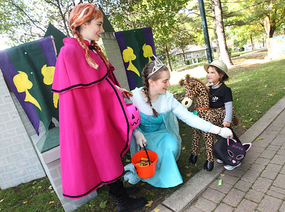 Candace H. Johnson-For Shaw Media Princess Anna and Queen Elsa give some candy to Alexa Garcia, 3, of Gurnee on the Trick or Treat Path at Viking Park in Gurnee. Sisters Jillian and Alyssa Hadding, both 17, of Gurnee portrayed the Disney characters. The event was sponsored by the Gurnee Park District. (10/13/18)