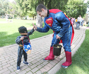 Candace H. Johnson-For Shaw Media Samuel Sagum, 3, as Batman, gives a high-five to Patrick Bodame, as Superman, both of Gurnee on the Trick or Treat Path at Viking Park in Gurnee. Bodame is the fitness manager for the Gurnee Park District.The event was sponsored by the Gurnee Park District. (10/13/18)