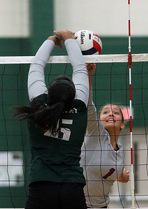 Candace H. Johnson-For Shaw Media Grayslake Central's Elisabeth Koshy and Antioch's Cenie Frieson joust at the net in the first set at Grayslake Central High School in Grayslake. Grayslake Central won 25-22, 25-20. (10/16/18)