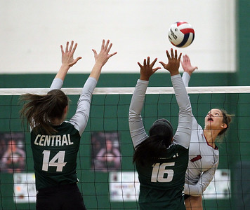 Candace H. Johnson-For Shaw Media Grayslake Central's Kathryn Bullman and Elisabeth Koshy put up a block against Antioch's Cenie Frieson in the first set at Grayslake Central High School in Grayslake. Grayslake Central won 25-22, 25-20. (10/16/18)