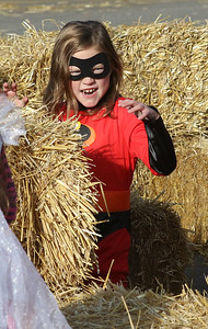 Charlotte Soule, 8, of Round Lake Beach scares visitors in the hay maze during the Haunted Trail & More Family Fall Festival at the Lindenhurst Park District's Lippert Community Center in Lindenhurst. (10/13/18)