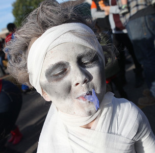 Jimmy Vick, of Lindenhurst, dressed as a mummy, blows a toy whistle he won after playing a game during the Haunted Trail & More Family Fall Festival at the Lindenhurst Park District's Lippert Community Center in Lindenhurst. (10/13/18)