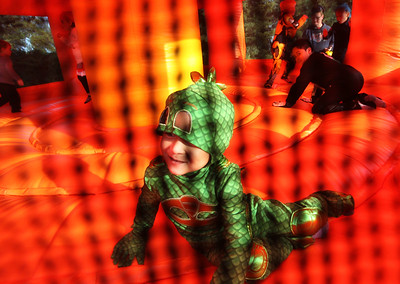 Noah Guzman, 3, of Lindenhurst takes a break from jumping in an inflatable during the Haunted Trail & More Family Fall Festival at the Lindenhurst Park District's Lippert Community Center in Lindenhurst. (10/13/18)