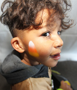 Kyrie Golston, 3, of Antioch shows off his new candy corn tattoo on his face during the Haunted Trail & More Family Fall Festival at the Lindenhurst Park District's Lippert Community Center in Lindenhurst. (10/13/18)