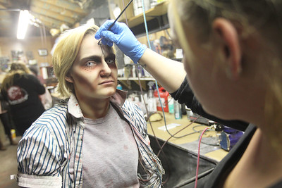 Candace H. Johnson-For Shaw Media Kassi Myers, 17, of Johnsburg is transformed into a creepy witch by makeup artist Tiffany Beaudry, of Fox Lake at the Realm of Terror Haunted House on Rollins Road in Round Lake Beach. (10/13/18)