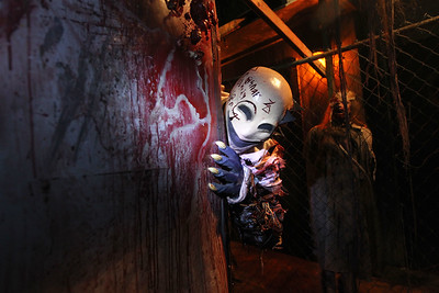 Candace H. Johnson-For Shaw Media Robert Stang, of Volo, a ghoul, welcomes visitors as they make their way through the Realm of Terror Haunted House on Rollins Road in Round Lake Beach. (10/13/18)