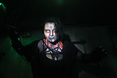 Candace H. Johnson-For Shaw Media Cydney Opitz, 21, of Gurnee gets ready to scare people in the crucifixion room at the Realm of Terror Haunted House on Rollins Road in Round Lake Beach. (10/13/18)