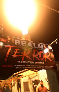 Candace H. Johnson-For Shaw Media Adam Hermes, of Round Lake, security, sets off the flame thrower to greet visitors at the Realm of Terror Haunted House on Rollins Road in Round Lake Beach. (10/13/18)